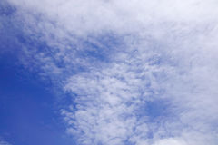 Blue sky with clouds at sunny day Stock Photography