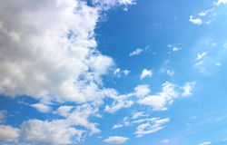 Blue sky and clouds. In sunshine stock photography