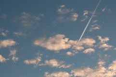 Blue sky with clouds thin morning plane trip away. White smoke Royalty Free Stock Image