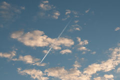 Blue sky with clouds thin morning plane trip away. White smoke royalty free stock images