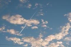 Blue sky with clouds thin morning plane trip away. White smoke Stock Photo