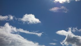 Blue sky with clouds, time lapse stock footage