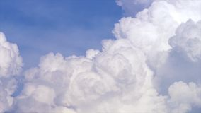 Blue sky with clouds timelapse. White big cloud on blue sky. a big and fluffy cumulonimbus cloud in the blue sky. Edge Royalty Free Stock Photos