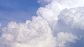 Blue sky with clouds timelapse. White big cloud on blue sky. a big and fluffy cumulonimbus cloud in the blue sky. Edge Stock Photos