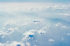 Blue sky with clouds, The upper layers of the atmosphere. Blue sky with clouds, shot from an airplane. The upper layers of the atmosphere stock photo