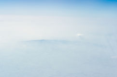 Blue sky with clouds, The upper layers of the atmosphere. Blue sky with clouds, shot from an airplane. The upper layers of the atmosphere stock photography