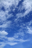 Blue sky and clouds. Vertical Royalty Free Stock Image
