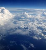 Blue sky clouds view from aircarft airplane Royalty Free Stock Photo