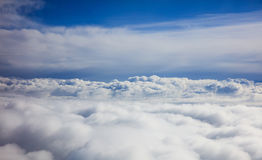 Blue sky and clouds - view from plane window Royalty Free Stock Images