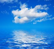 Blue sky with clouds on the water Stock Image