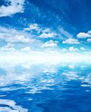 Blue sky clouds and water Stock Image