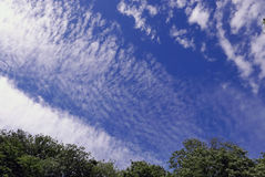 Blue sky with clouds, white cyrus and stratus. Blue fluffy summer sky with stratus and white cumulus for background, illustration Royalty Free Stock Photos