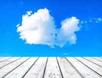 Blue sky with clouds and wooden plank Stock Photos