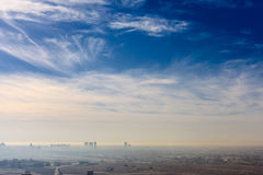 Dubai city skyline. Blue sky and cloudscape over Dubai city skyline with desert in foreground, United Arab Emirates Stock Image