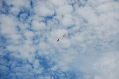Blue sky clound and small Kite center. Kite on Blue sky and white clound Stock Photos