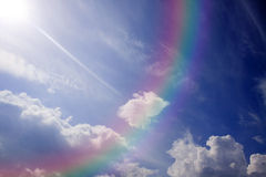 Blue sky and colorful rainbow. Royalty Free Stock Images