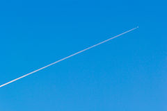 Blue sky with contrail Stock Photo