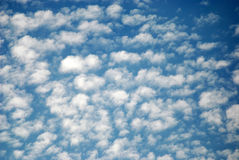 Blue sky with cotton clouds Stock Images