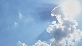 Blue sky with cottony clouds. Blue The sky with cottony clouds with sun royalty free stock photography