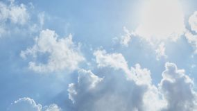 Blue sky with cottony clouds. Blue The sky with cottony clouds with sun royalty free stock photos