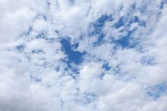 Blue sky covered with clouds, only some blue spots Royalty Free Stock Photo