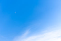 Blue sky with a crescent moon Royalty Free Stock Photo