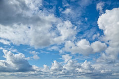 Blue sky with cumulus clouds Stock Images