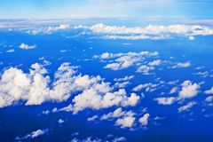 Blue sky with cumulus clouds from an airplane window. Blue sky with cumulus clouds from an airplane stock images