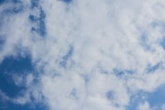 Blue sky and cumulus clouds. Background light air bright brightly climate cloudscape cloudy condensation day environment fluffy freedom heaven high idyllic stock photo