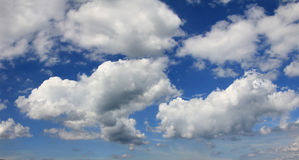 Blue sky with cumulus clouds Stock Photos