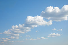 Blue sky with cumulus clouds built abreast Stock Image
