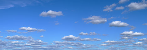 Blue sky with cumulus clouds panoramic view environmental meteo. Clouds sky cumulus panorama bright blue atmosphere meteo backdrop weather Royalty Free Stock Photo