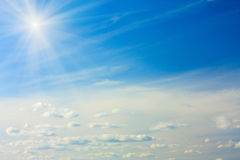 Blue Sky with Cumulus Clouds and Sun Stock Photos