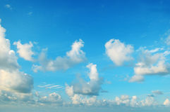Blue sky and  cumulus clouds Stock Photos