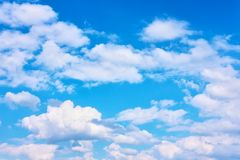 Blue sky with cumulus clouds stock image