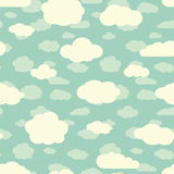 Blue sky and cute white clouds seamless pattern in retro colors Royalty Free Stock Photos