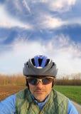 Blue sky and cyclist Stock Photos