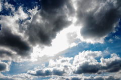 Blue sky dark clouds with the sun Royalty Free Stock Photos