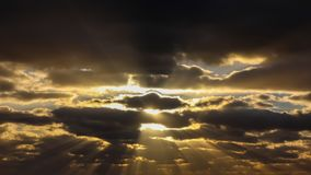 Blue sky and dark clouds with sunlight stock images
