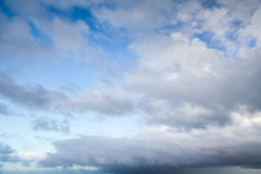 Blue sky with dark stormy clouds, nature background Royalty Free Stock Photo