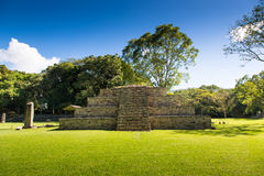 Blue sky day in an ancient pyramid at pre-columbian city of Copan, Honduras. Central America Royalty Free Stock Photos