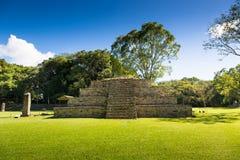 Blue sky day in an ancient pyramid at pre-columbian city of Copan, Honduras Royalty Free Stock Photos
