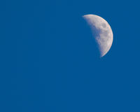 Blue sky daytime half moon Royalty Free Stock Images