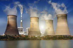 Blue sky distributed power plant`s cooling tower royalty free stock image