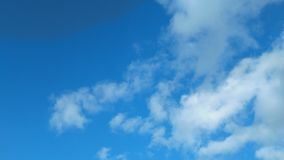 Blue sky dotted with clouds royalty free stock photography