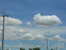 Blue sky with electric pole Royalty Free Stock Image