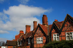 Blue sky england. Image of village cottages on a blue sky day in sunny england royalty free stock images