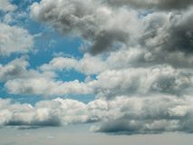 Blue sky a few white clouds.  royalty free stock photography