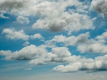 Blue sky a few white clouds.  stock images