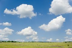 Blue sky and field Stock Images
